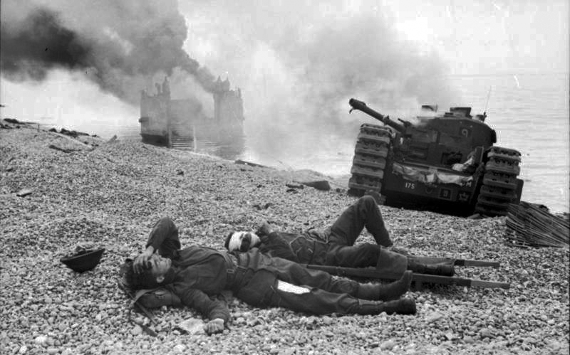 Wounded Canadian soldiers and destroyed equipment on the beach at Dieppe.