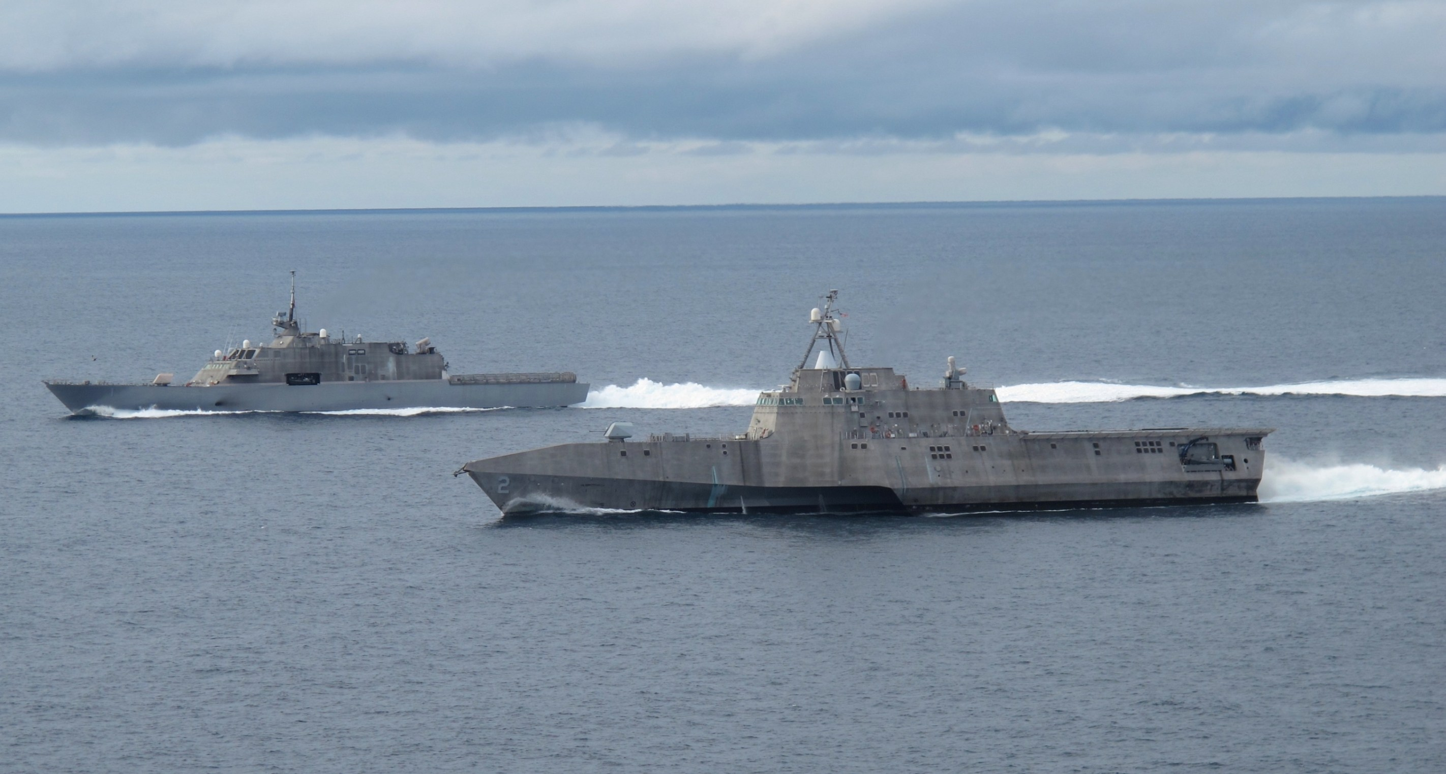 he first of class littoral combat ships USS Freedom (LCS-1), left, and USS Independence (LCS-2), maneuver together during an exercise