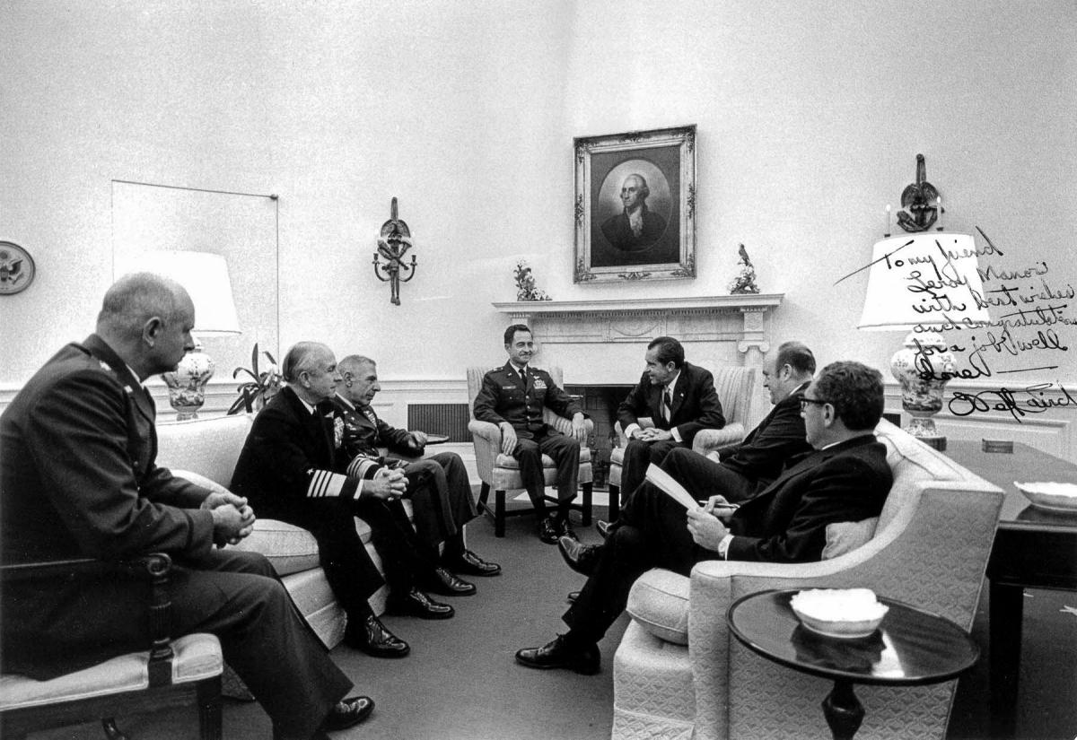 President Nixon meets with military leaders in the Oval Office to discuss results of the raid on Son Tay prison camp in North Vietnam, 31 October 1970.