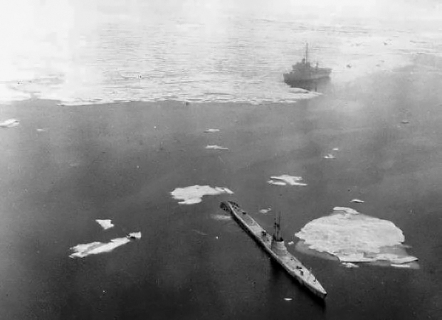 USS Redfish (SS-395) in a polynya in 1952, with the USS Burton Island (AG-88) in the background.