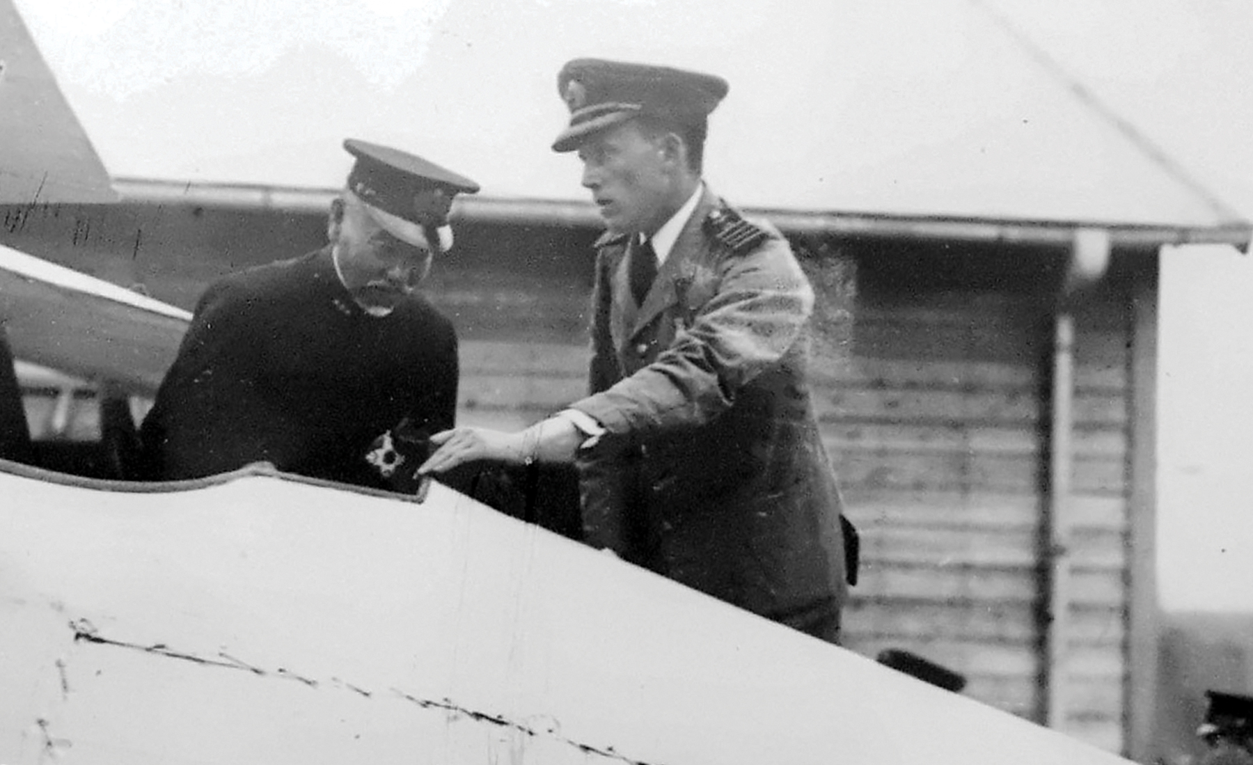 William Forbes-Sempill shows Japanese Admiral Heihachiro Togo the interior of a British-built Sparrowhawk fighter in 1921.