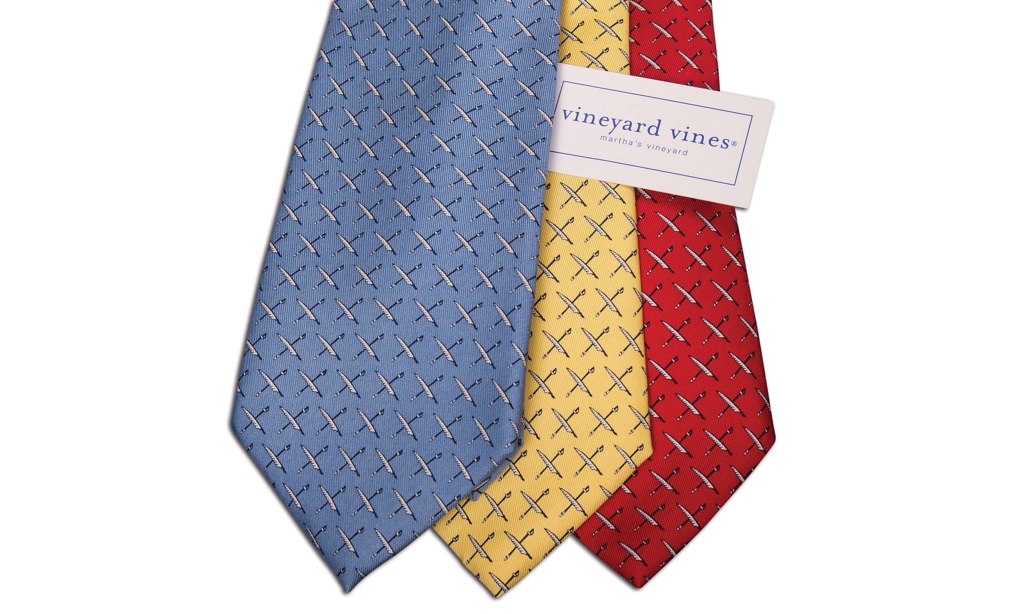 Blue, Yellow, and Red Naval Institute Vineyard Vines Ties with label