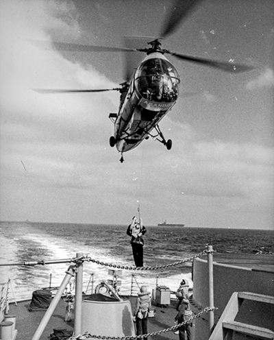 Helo-hopping from an aircraft carrier to the stern of a destroyer in the late 1950s