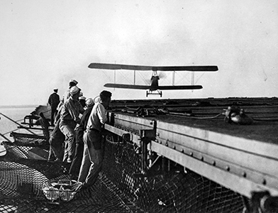 Aeromarine 39B landing on USS Langley (CV-1) during trials in October 1921.