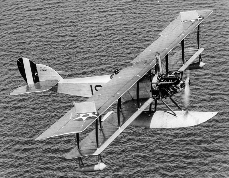 An aerial side view of a U.S. Navy N-9 training aircraft in flight.