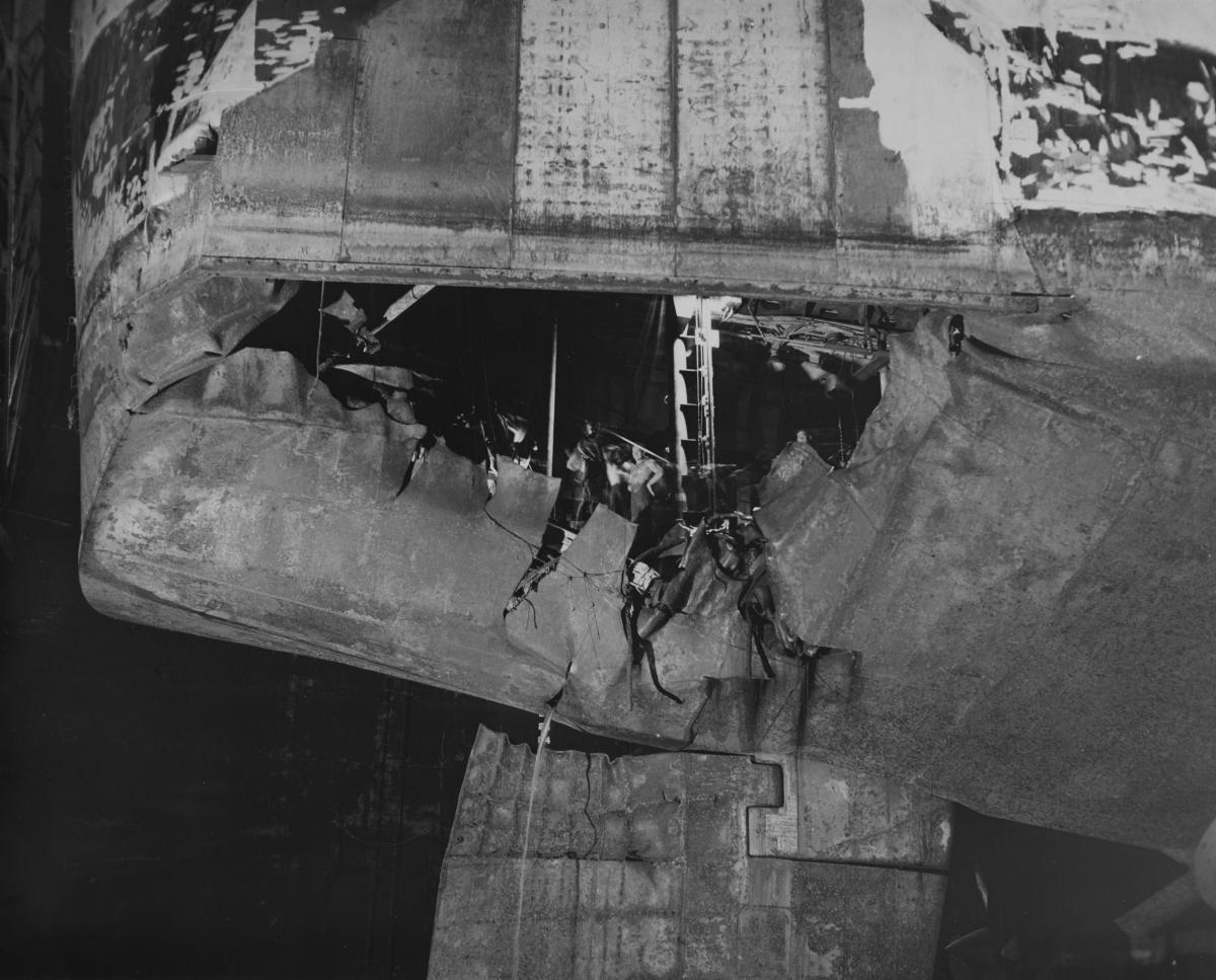 Extensive torpedo damage to the stern and rudder of USS Houston (CL-81).