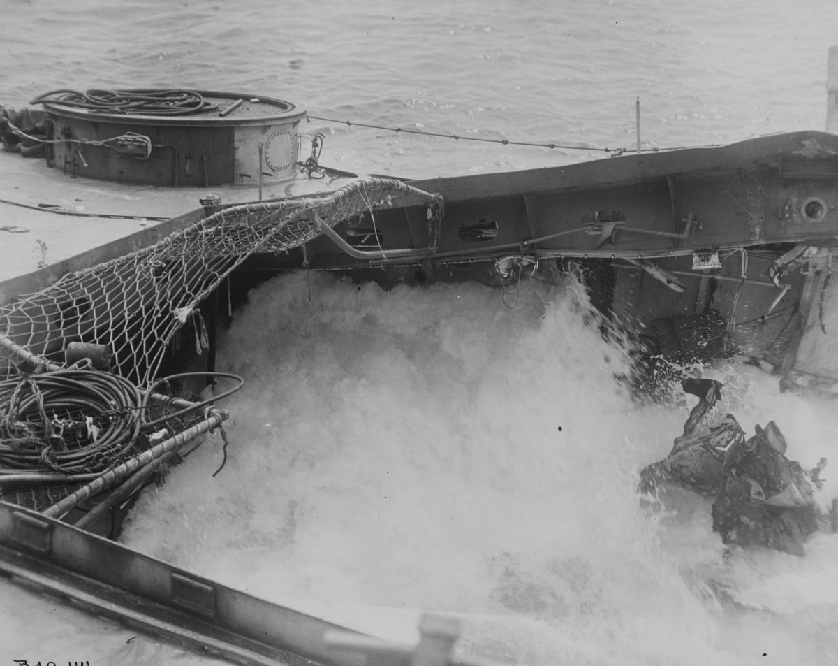 Flooding in the USS Houston's (CL-81) hangar after a second torpedo hit at the Battle of Formosa.