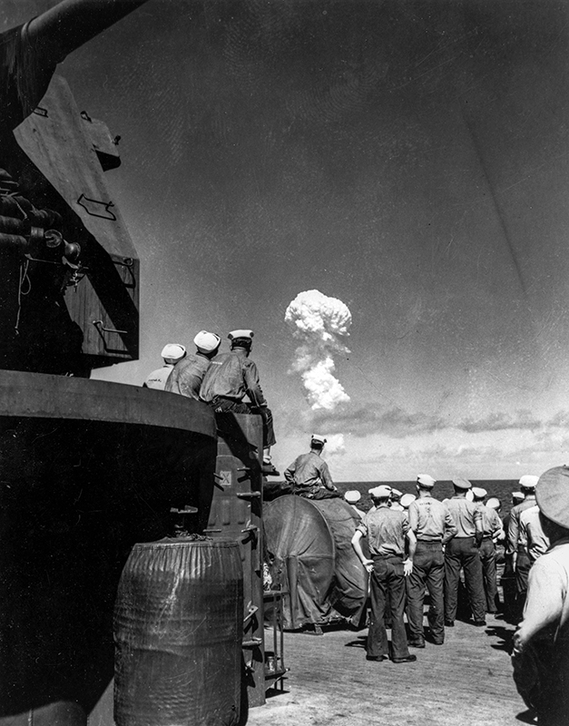 Sailors watch the mushroom cloud of the Able test during Operation Crossroads