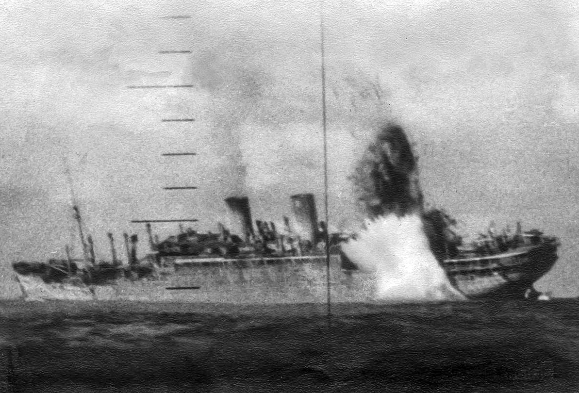 View of a Japanese ship sinking as seen through a submarine periscope.
