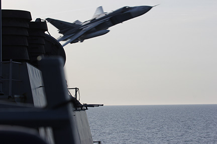 A Russian Sukhoi SU-24 attack aircraft making a very low pass close to the U.S. guided-missile destroyer USS Donald Cook (DDG-75) in the Baltic Sea.
