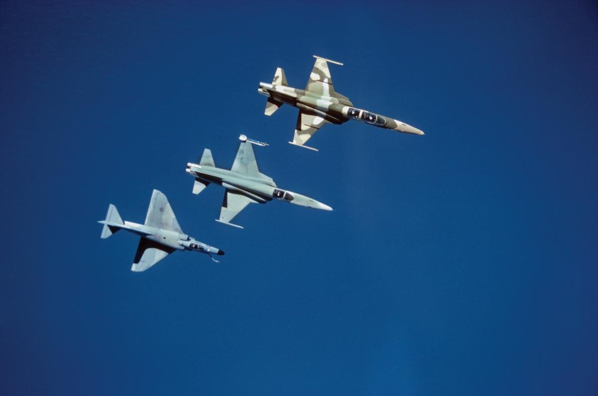 Overhead view of three Navy adversary aircraft, two F-5 Tiger IIs and one A-4 Skyhawk