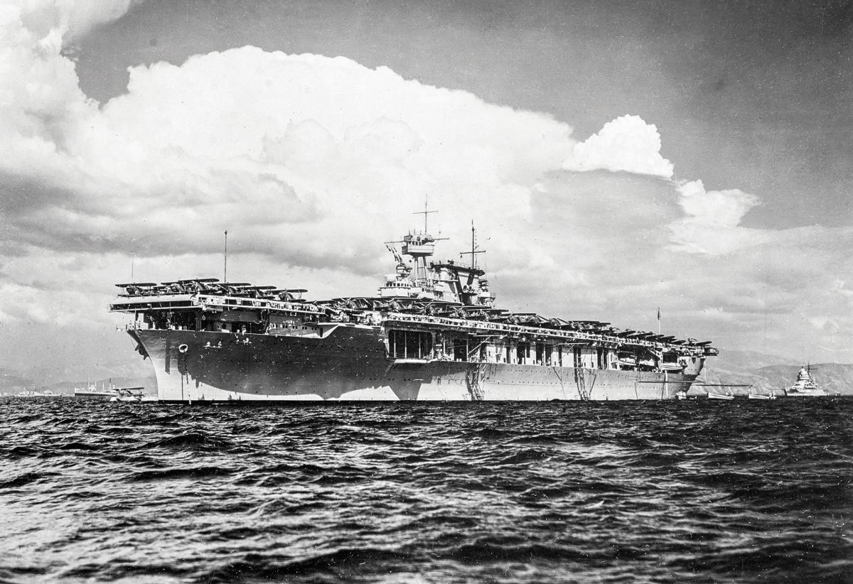Surface port bow view of the USS Yorktown (CV-5) riding at anchor