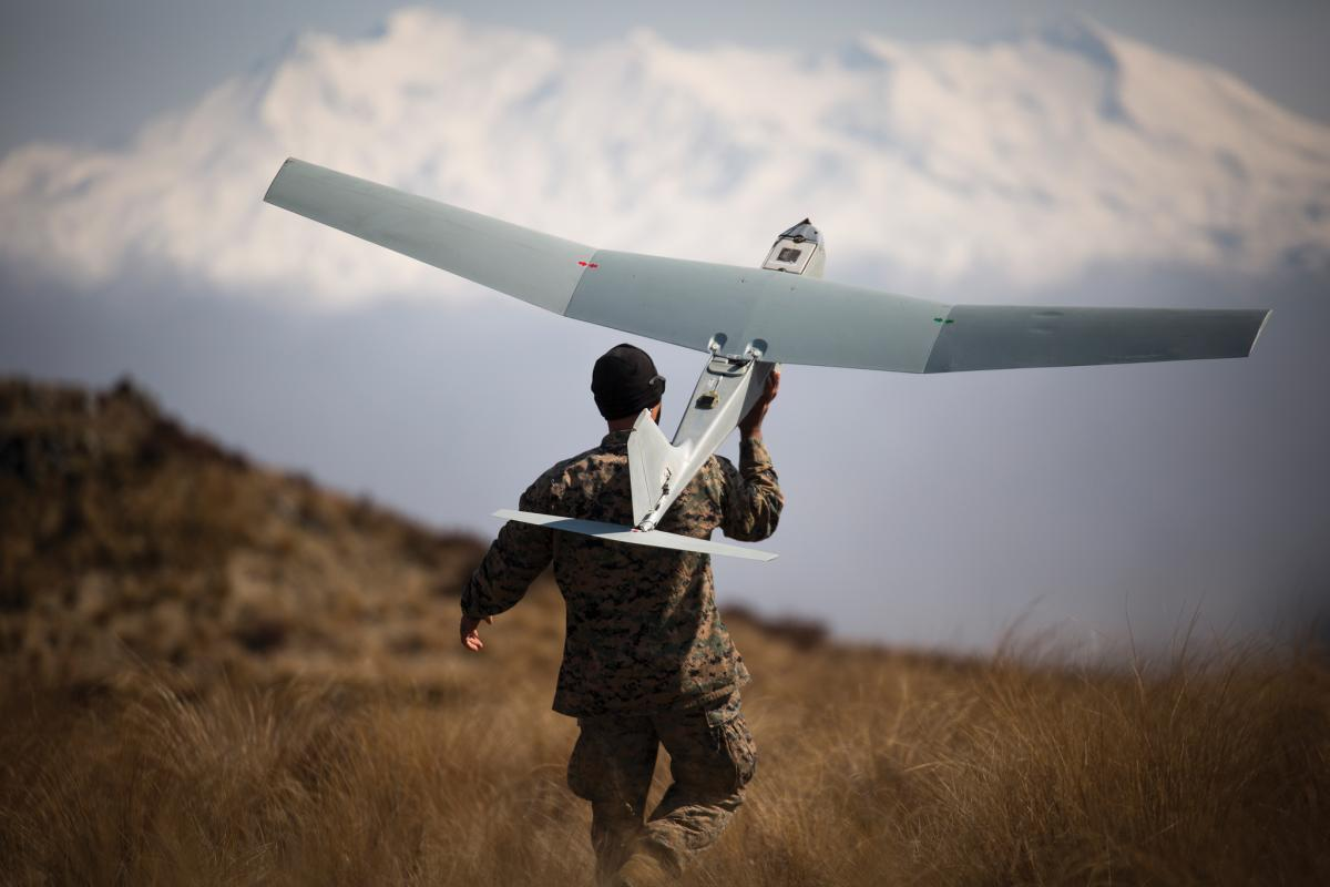 U.S. Marine Corps Sgt. Kevin Ware prepares to launch a Small Unmanned Aircraft System, as part of exercise Joint Assault Signals Company Black, Waiouru Military Camp, New Zealand, Sept. 13, 2018
