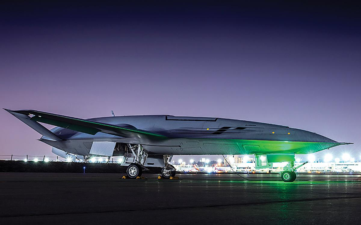 Ground-to-ground right side view of a  MQ-25 Stingray at night