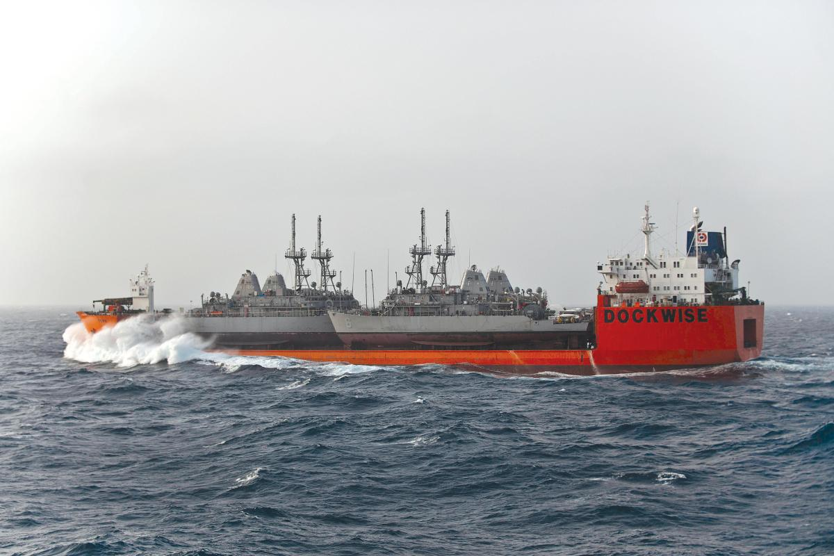The Military Sealift Command chartered M/V Tern, a Netherlands-flagged float-on/float-off ship, transits the Indian Ocean while carrying four Avenger-class mine counter measure ships to their new homeport in Manama, Bahrain
