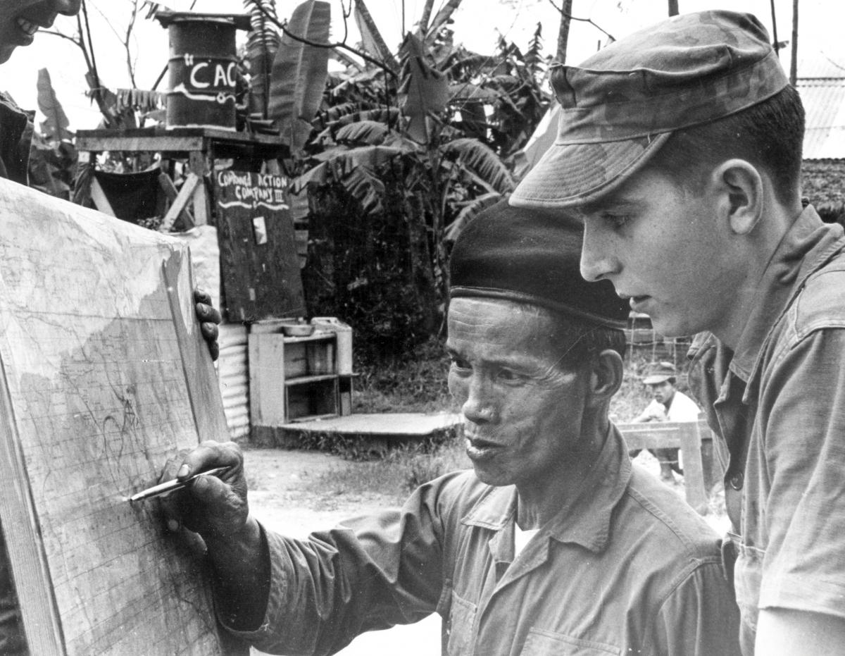 U.S. Marine Advisor speaking to his counterpart in a South Vietnamese Combined Action Platoon