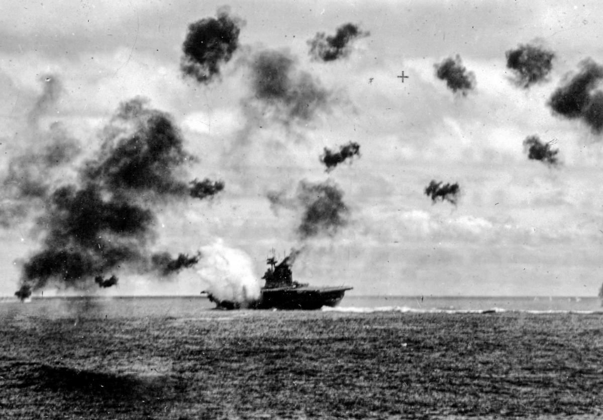 The USS Yorktown (CV-5) is hit by one of two torpedoes that slammed into her port side during the aerial strike
