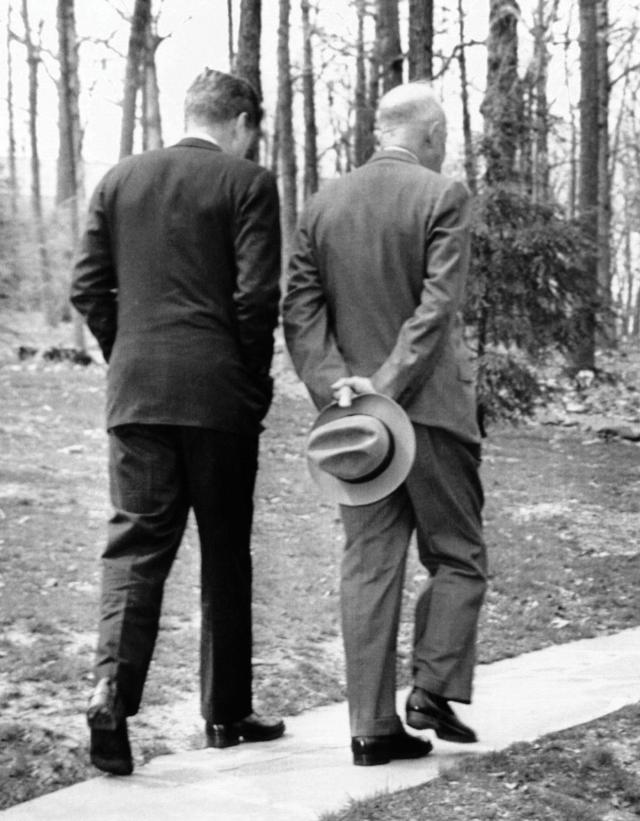 "A grim walk in the woods: President Kennedy and his predecessor, Dwight D. Eisenhower, commiserate at Camp David in the wake of the botched mission. ""Victory has a hundred fathers,"" JFK famously observed at his post–Bay of Pigs press conference, ""and defeat is an orphan."""