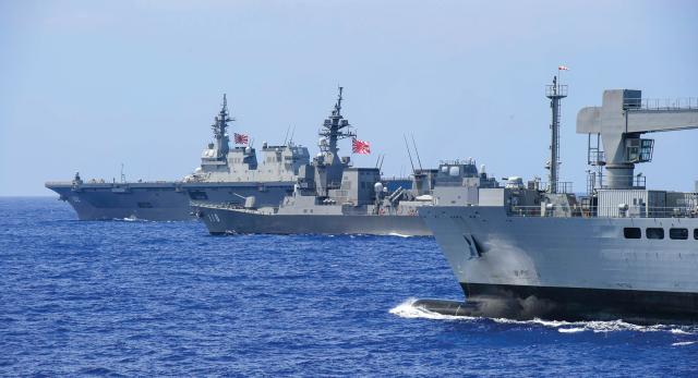 ships from the Indian Navy and Japan Maritime Self-Defense Force participate in Malabar, a trilateral exercise
