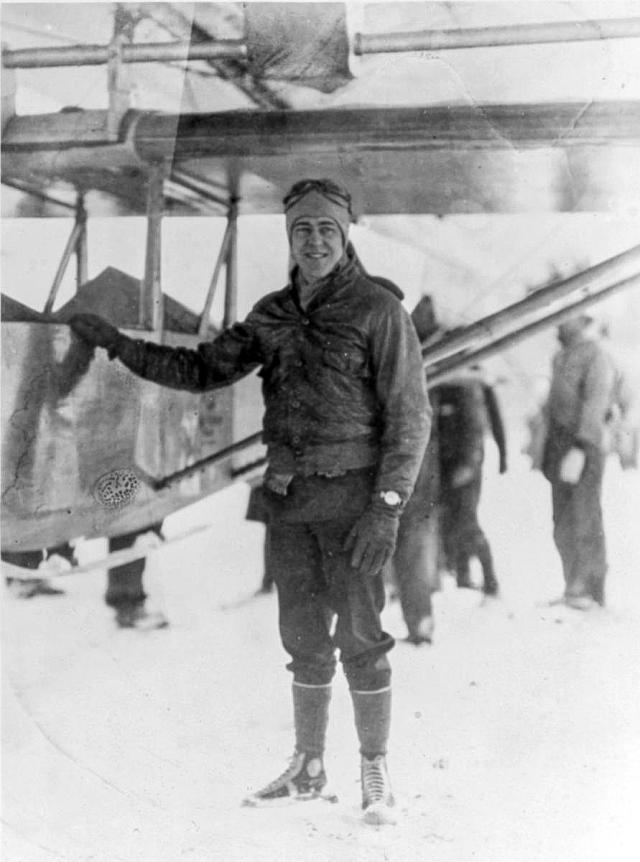 Lieutenant Commander Barnaby standing with his glider that's attached to the airship USS Los Angeles (ZR-3), NAS Lakehurst, NJ, January 31st, 1930.