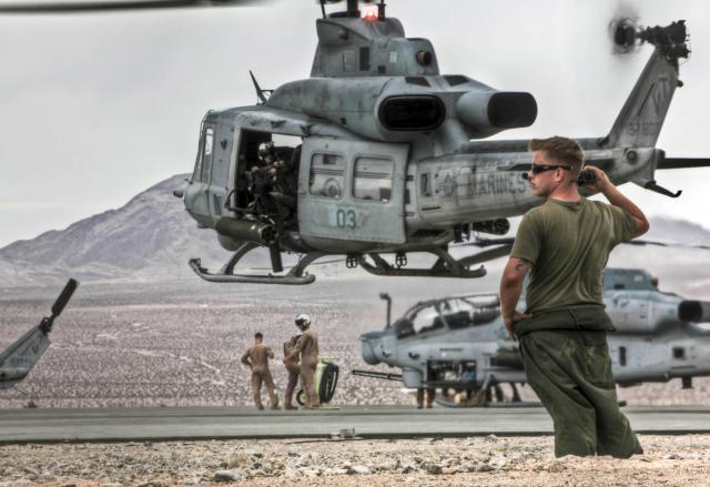 rine monitors flight launch operations at 29 Palms as part of Marine Light Attack Helicopter Squadron 367, 2011.