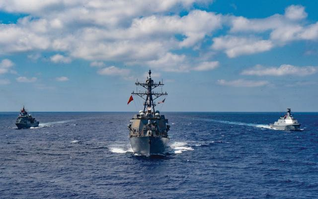 The guided-missile  destroyer USS Winston S. Churchill (DDG-81), middle, executes  a passing exercise  with the Turkish Navy frigates Barbaros and Burgazada in the  Mediterranean Sea,  26 August.