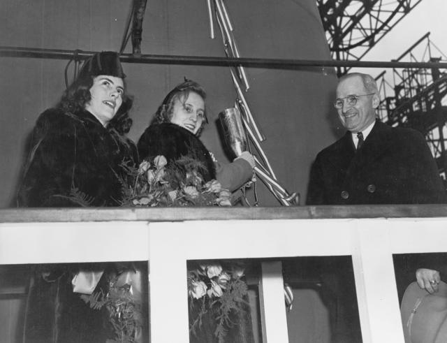 New York Navy Yard, 29 January 1944: (L. to r.) Maid of Honor Jane Lingo; Margaret Truman, sponsor; and Senator Harry S. Truman of Missouri are on the platform just prior to the launching of the battleship Missouri. Senator Truman was destined for bigger things—as was the ship.