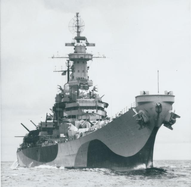 A starboard bow view of the Missouri showing her Atlantic Ocean dazzle-pattern camouflage.