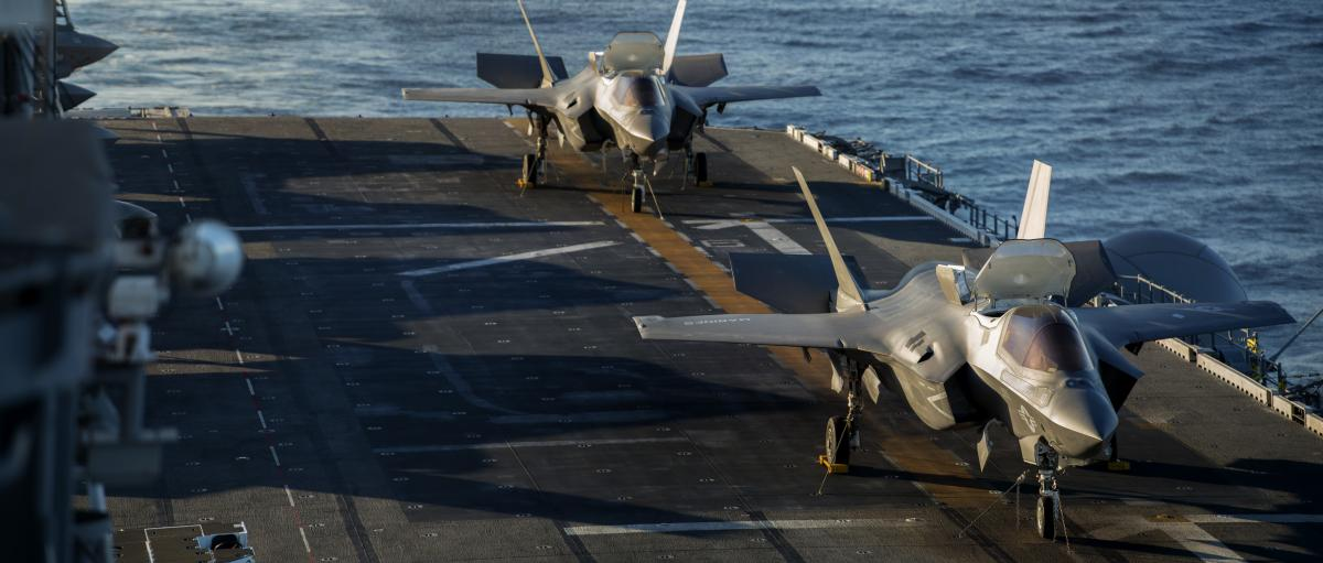 Two F-35B Lightning II's sit on the flight deck aboard USS America (LHA 6), November 17, 2016, for the Lightning Carrier Proof of Concept Demonstration