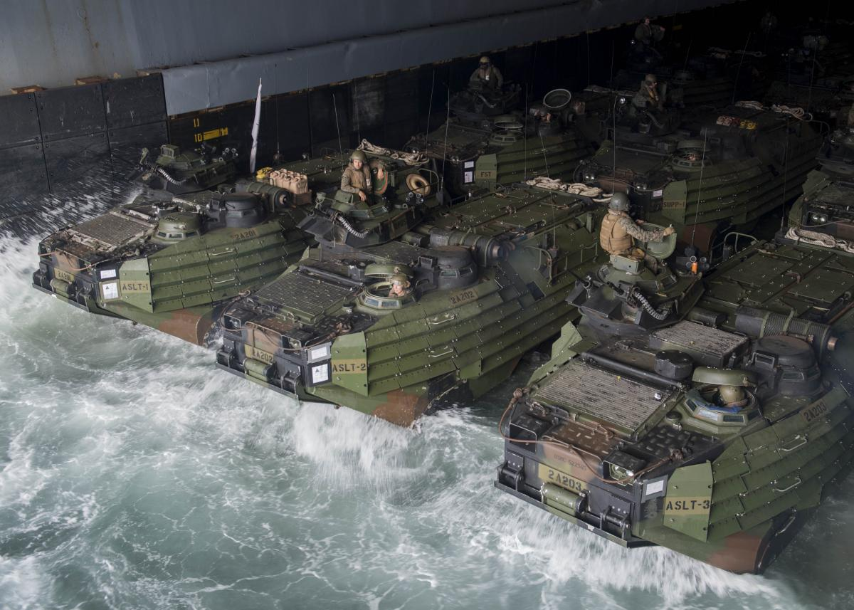 Marines and sailors, assigned to the 26 Marine Expeditionary Unit, stage amphibious assault vehicles in the well deck of the USS Oak Hill (LSD-51).