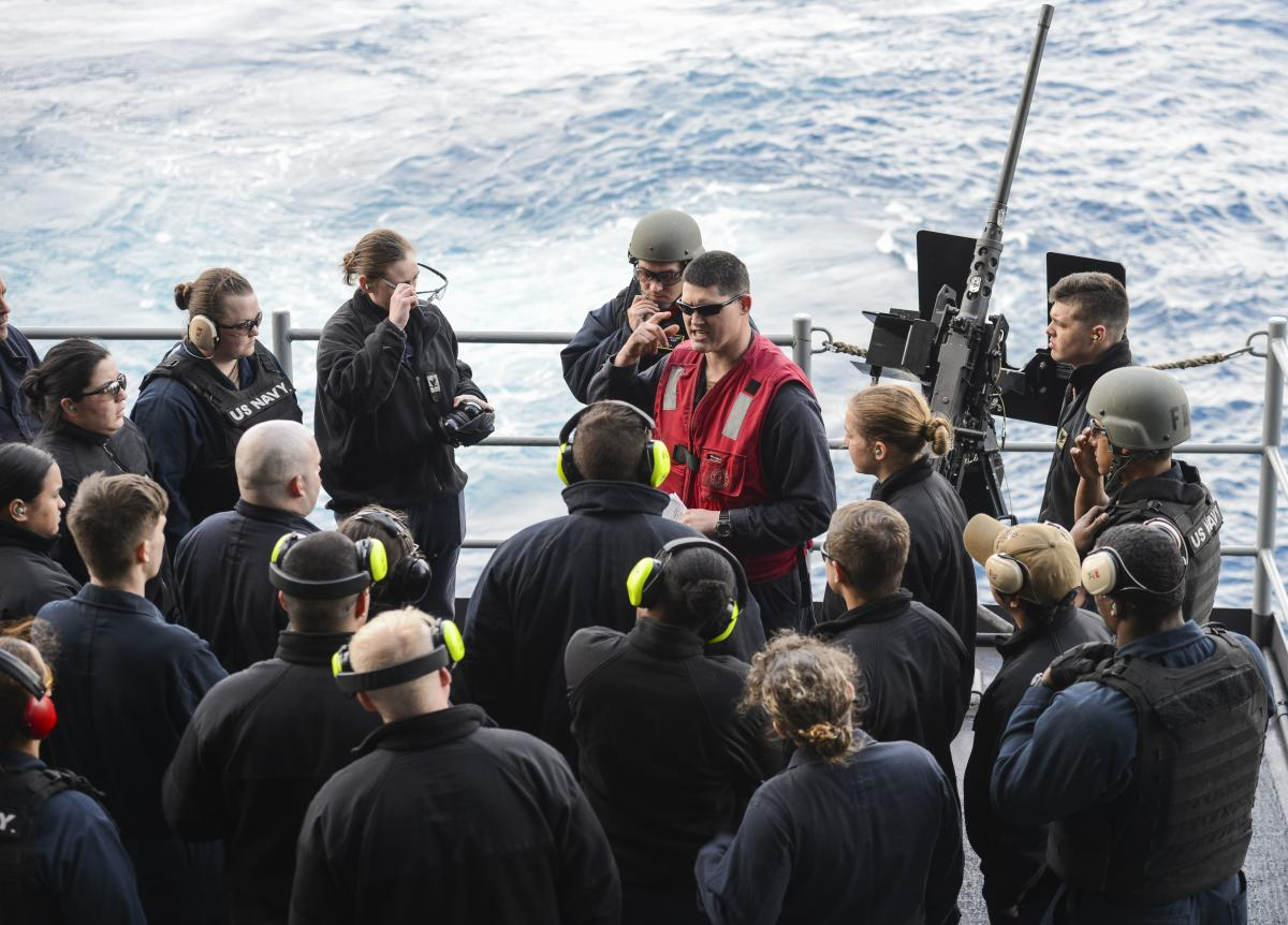 Sailors listen to a safety brief on board the USS Nimitz.