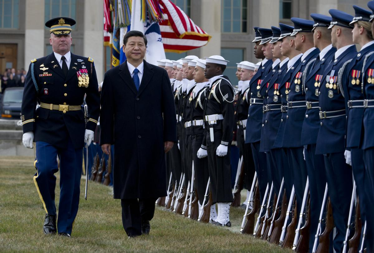 A full honors arrival ceremony welcomes Xi Jinping, center left, to the Pentagon in 2012.
