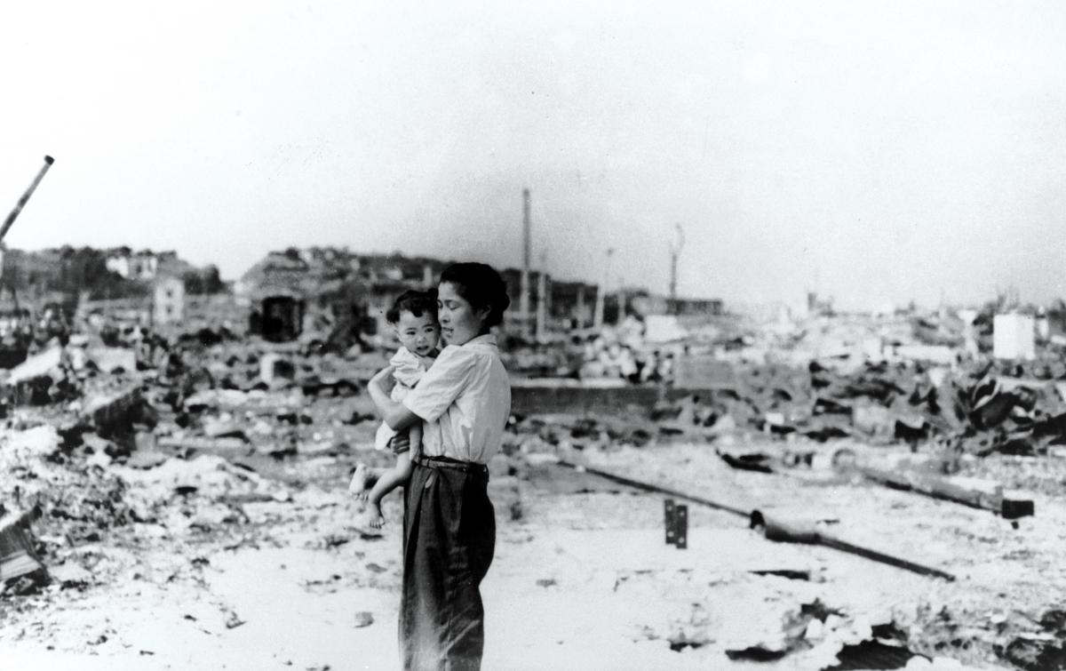 "A Japanese woman and child are surrounded by the rubble of a destroyed Tokyo in this September 1945 photo taken by a U.S. sailor. As Quartermaster Michael Bak observed, ""We saw nothing but ruins, and how people lived in that ruin is beyond me."""