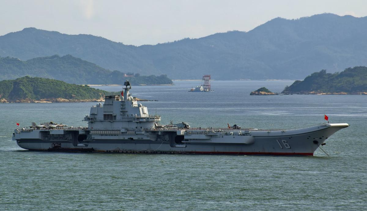 Chinese aircraft carrier Liaoning riding at anchor.