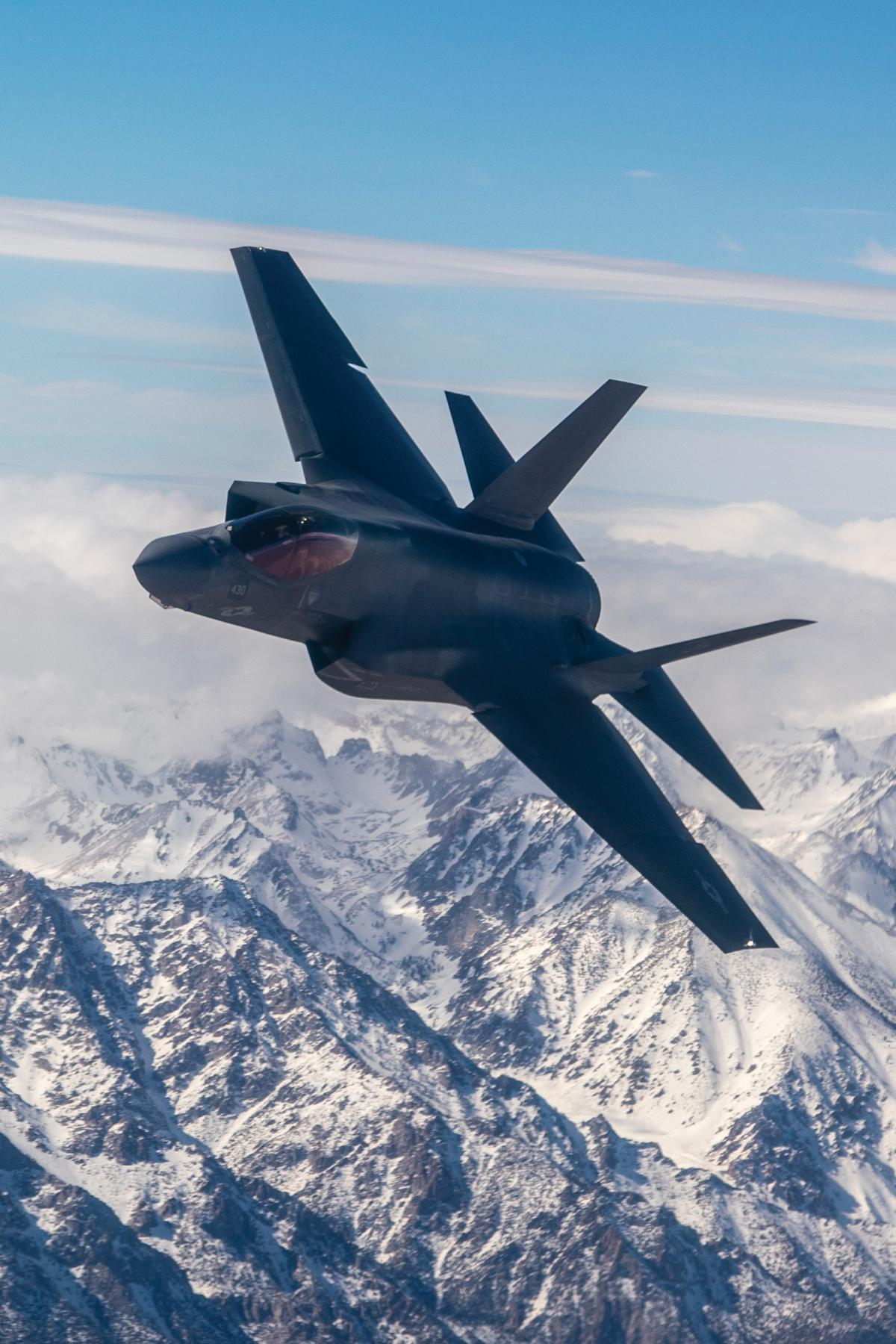"A Navy F-35C Lightning II from the ""Rough Raiders"" of Strike Fighter Squadron (VFA) 125 soars over the Sierra Nevada Mountain Range"