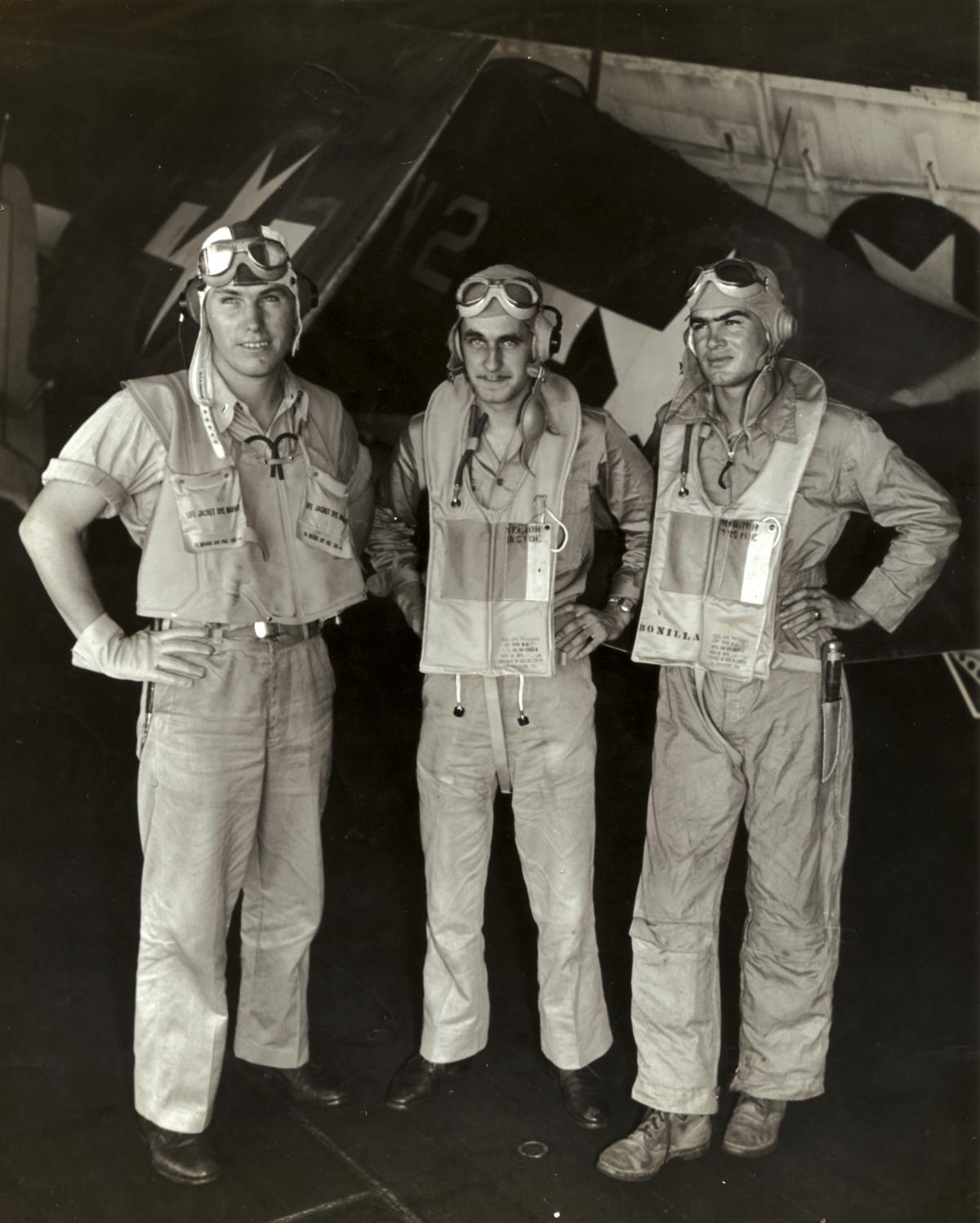 "Lieutenant (junior grade) William ""Mac"" McCarthy (center); the author, Aviation Ordnanceman Second Class Paul Bonilla (right); and Lieutenant (junior grade) Richard Johnson are pictured back on board the USS Lexington after being shot down and rescued."