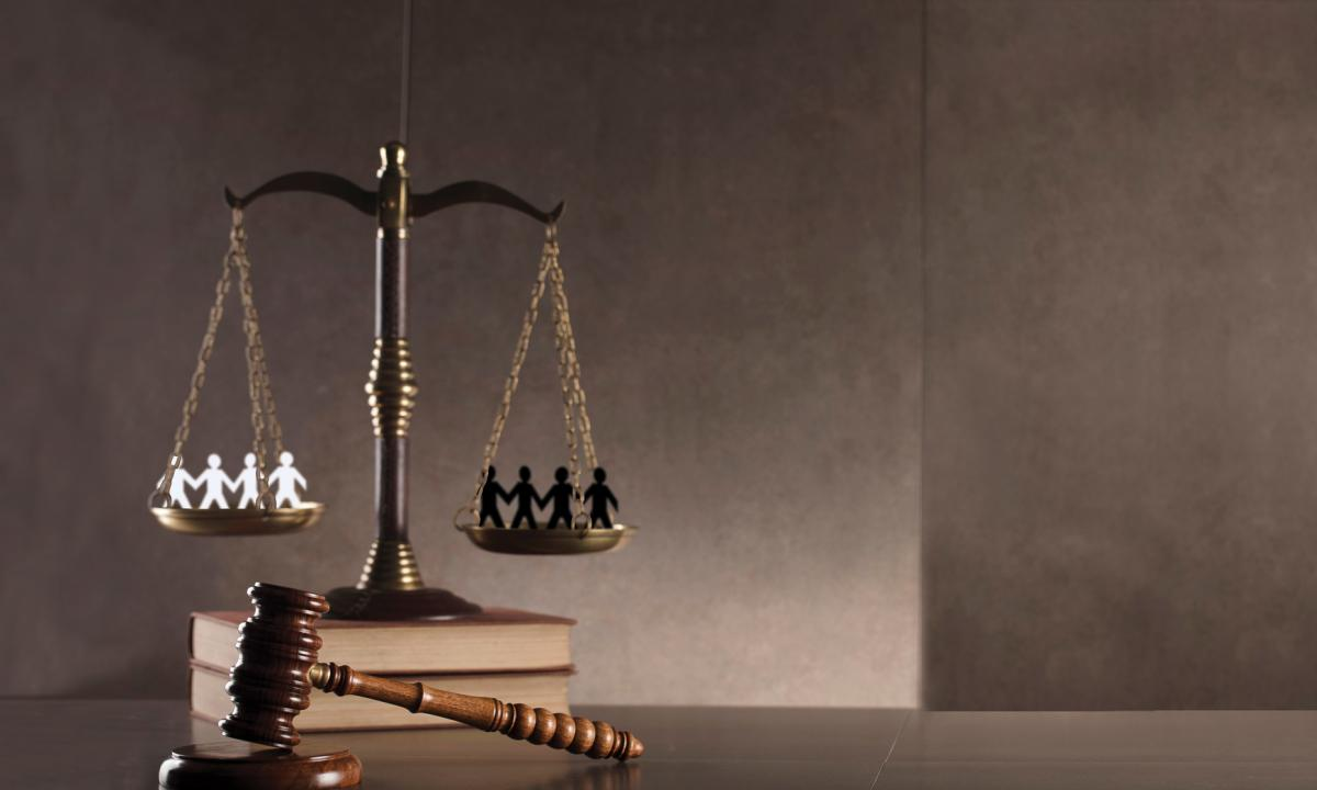Scales resting on books with gavel
