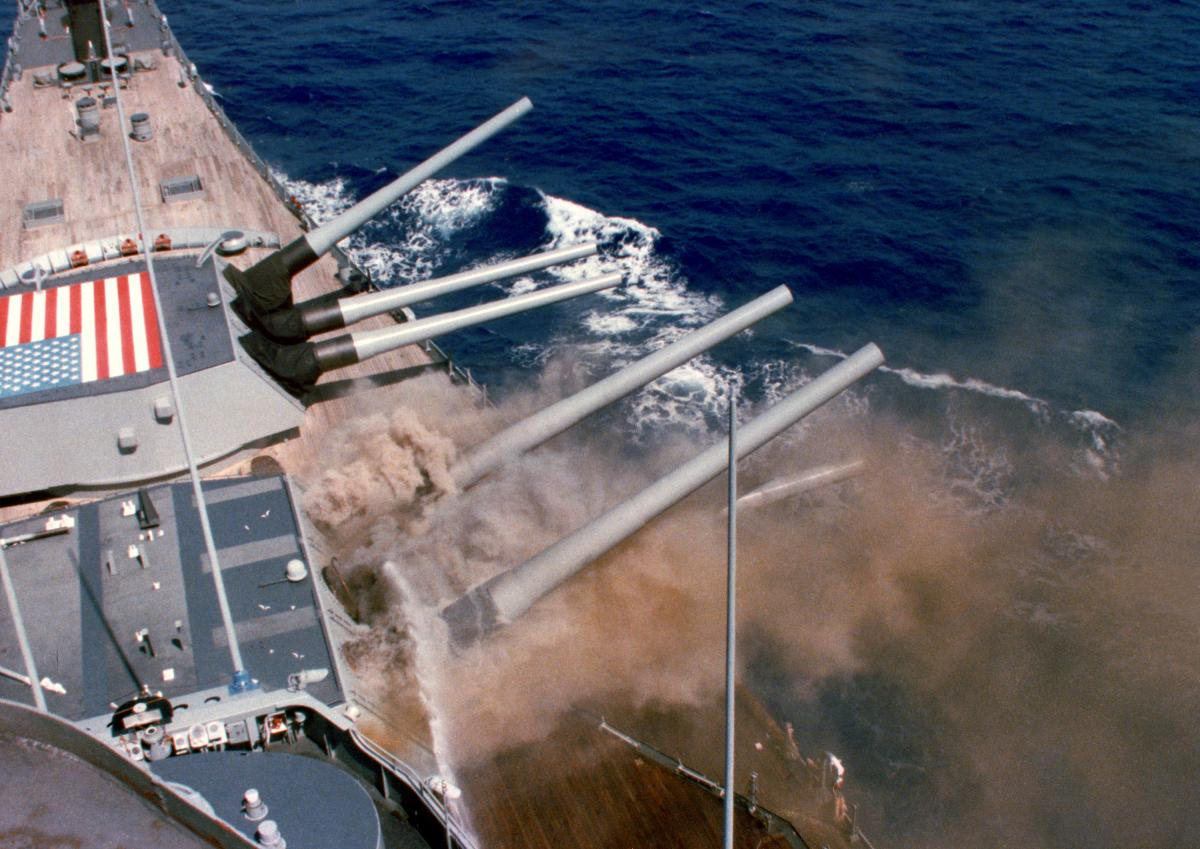 A photo taken from the bridge captures the explosion of the No. 2 16-inch gun turret aboard the battleship USS Iowa (BB-61)