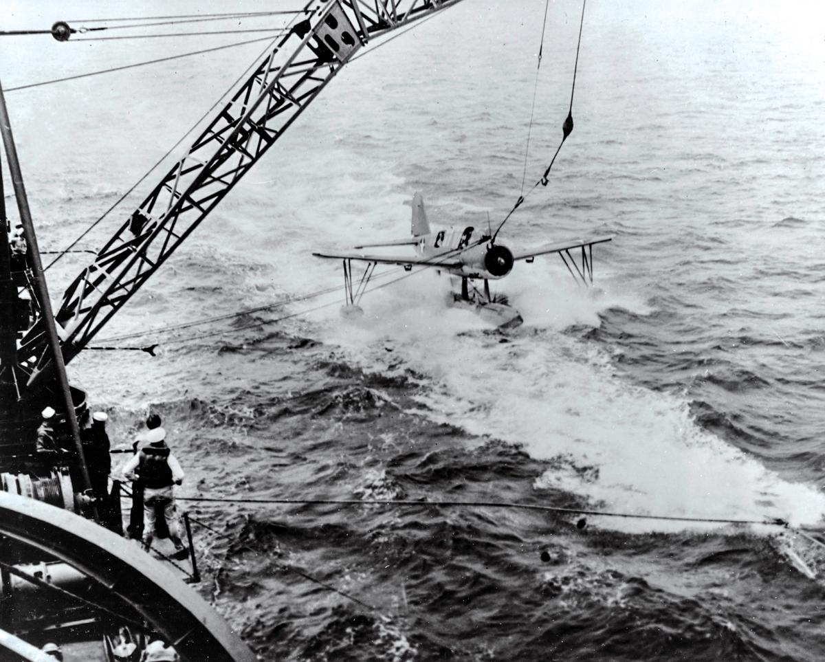 The USS Stevens (DD-479) tests the ship's aircraft recovery system.