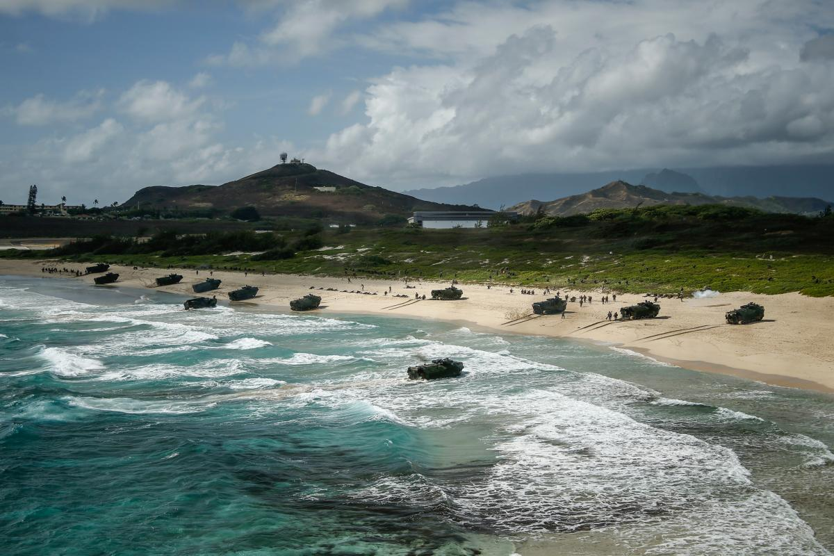 AAV-P7/A1 assault amphibious vehicles assigned to Combat Assault Company, 3rd Marine Regiment, unload service members during an amphibious landing demonstration as part of Rim of the Pacific (RIMPAC) exercise at Pyramid Rock Beach on Marine Corps Base Hawaii July 29, 2018