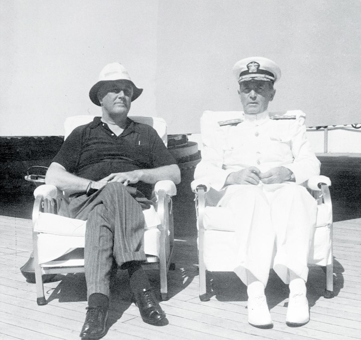 President Franklin Roosevelt relaxes with Chief of Naval Operations Admiral William Leahy on board the heavy cruiser USS  Houston (CA-30).