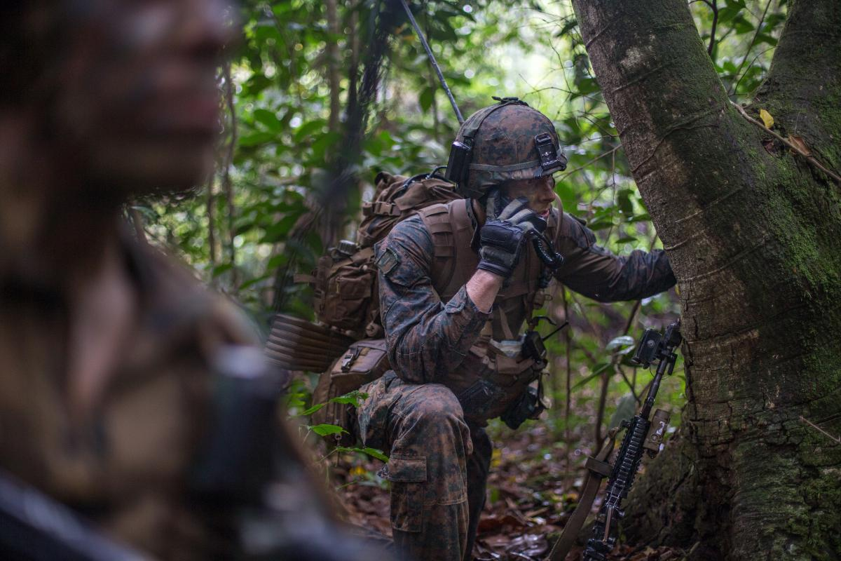 A U.S. Marine platoon commander gives orders over the radio during Exercise Valiant Mark 2019 on Tekong Island, Singapore.