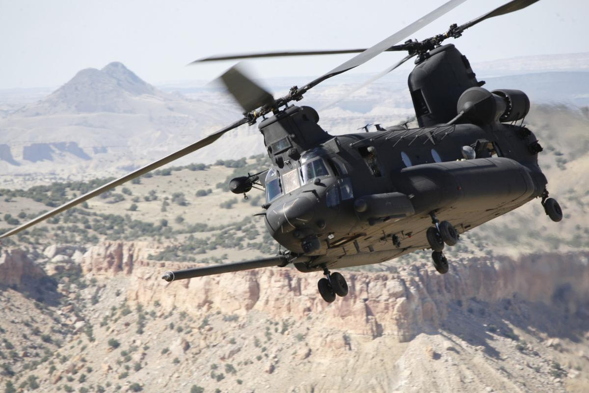 An Army MH-47 Chinook flies over Afghanistan.