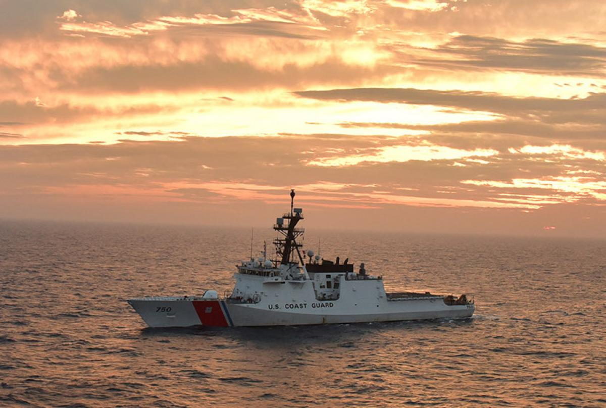 The USCGC Bertholf (WMSL-750) basks in a sunset glow in the Yellow Sea while deployed to the 7th Fleet area of responsibility in 2019.