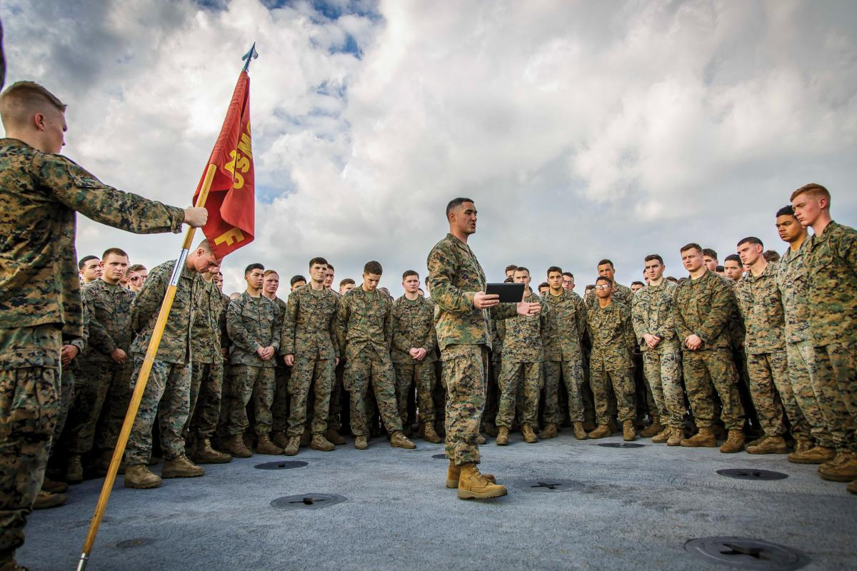 U.S. Marine Corps Capt. Joseph Murphy, center, commanding officer of Fox Company, Battalion Landing Team, 2nd Battalion, 6th Marine Regiment, 26th Marine Expeditionary Unit (MEU) and commander of troops aboard the dock landing ship USS Oak Hill (LSD 51), addresses Marines after a promotion ceremony aboard the Oak Hill in the Atlantic Ocean, Dec. 1, 2017