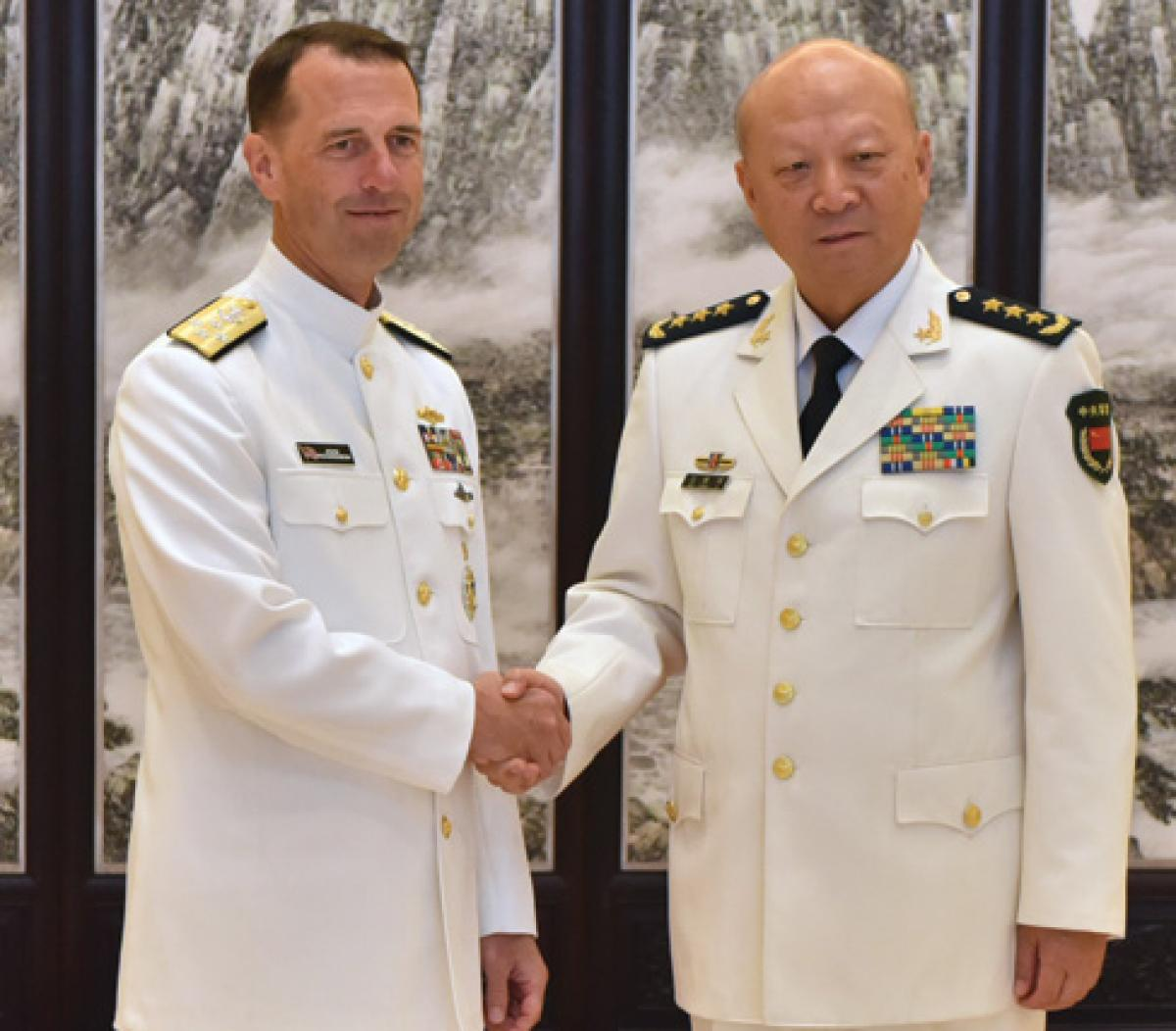 CNO Admiral John Richardson (left) shakes hands with Admiral Wu Shengli, Commander of the PLAN, at Chinese Navy Headquarters in Beijing during a July visit—just five days after the Permanent Court of Arbitration ruled against China in a South China Sea island territorial dispute. What signals do such engagements send to longtime U.S. allies?