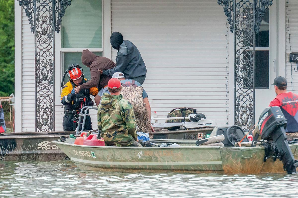 "Members of the ""Cajun Navy"" perform a rescue"