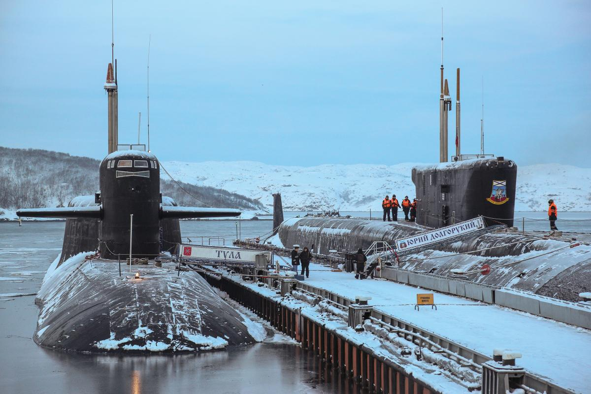 Nuclear-powered ballistic missile submarines K-114 Tula, left, and Yury Dolgorukiy are parked at the Northern Fleet submarine forces headquarter in Gadzhiyevo, Murmansk region, Russia
