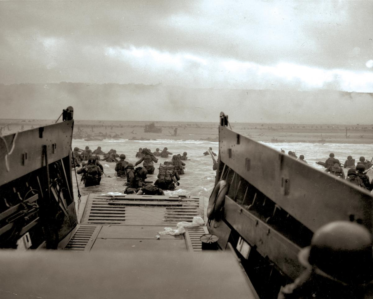 During Operation Neptune, GIs wade ashore on Normandy's Omaha Beach.