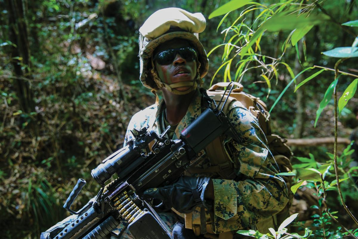 A Marine with Combat Logistics Battalion 31, 31st Marine Expeditionary Unit, provides security at the Jungle Warfare Training Center, Camp Gonsalves, Okinawa, Japan, May 22, 2018